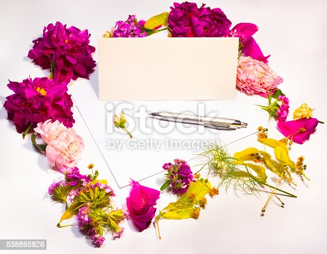 968272356istockphoto Flowers, envelope and pen on a lilac 538865826