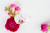 istock Flowers flat lay composition 1009966378