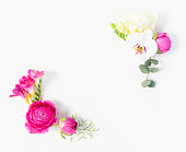 istock Flowers flat lay composition 1009984658