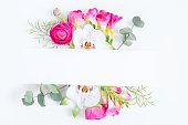 istock Flowers flat lay composition 1009984738