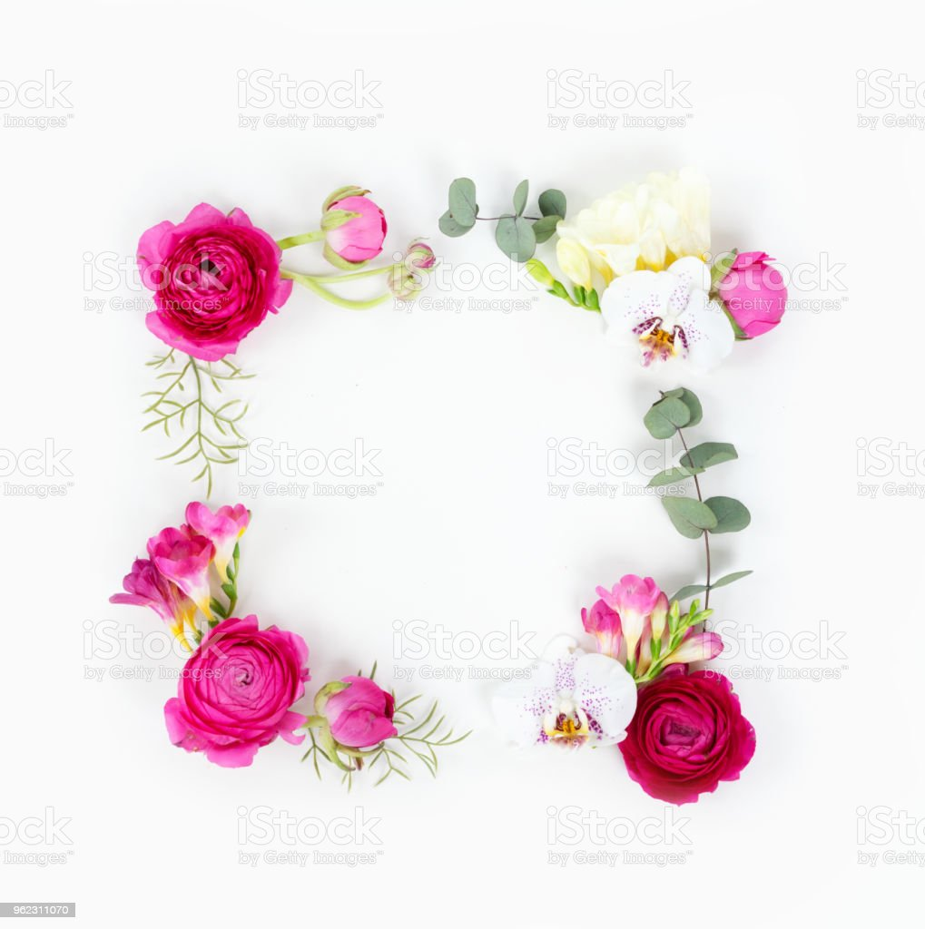 Flowers composition. Frame made of eucaliptus leaves and ranunculus...