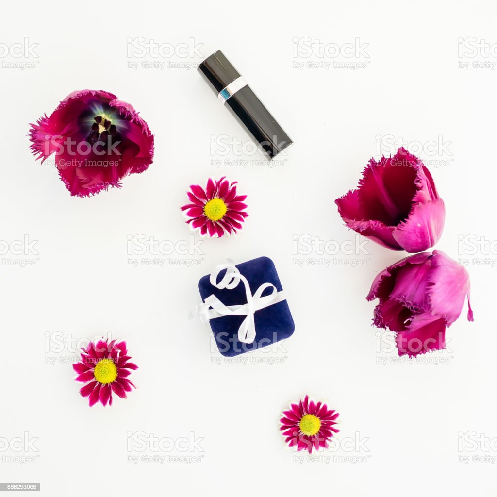 Flowers, gift and women's accessories. Flat lay, Top view. stock photo
