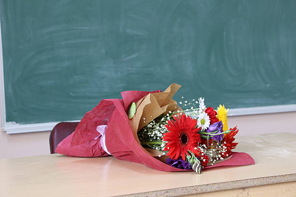 flowers gift given to teachers. - teachers day stock photos and pictures