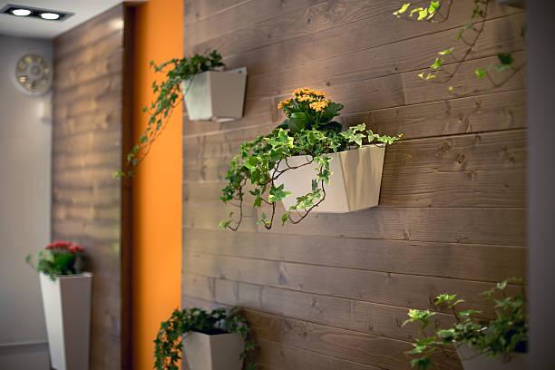 flowers hanging on a wooden office wall - naturholzmöbel stock-fotos und bilder