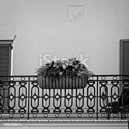 New Orleans, LA USA - May 9, 2018  -  Flowers in Basket on Baloney in The French B&W Quarter