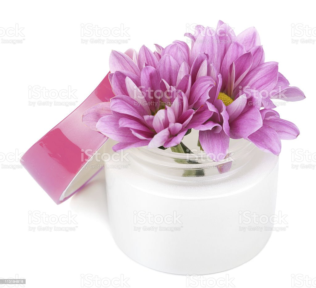 flowers in cosmetic bottle isolated royalty-free stock photo