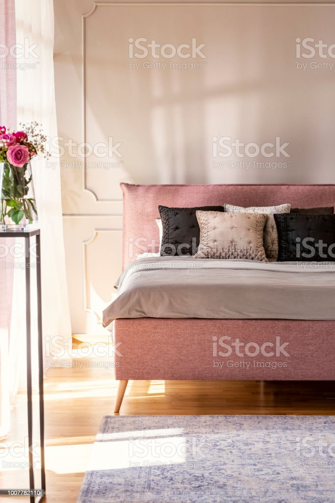 Flowers In Pink Bedroom Interior With Bed With Cushions ...