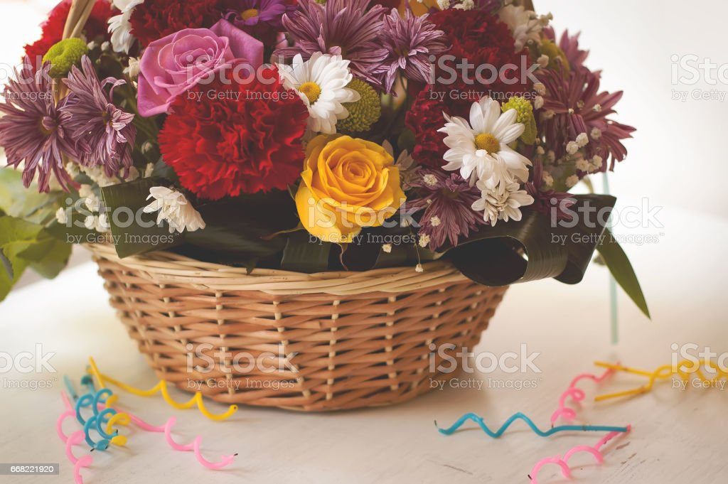 Flowers In The Basket And Happy Birthday Candles On Wooden Background Royalty Free Stock