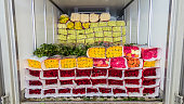 Opened back doors of the truck loaded with rose flowers. Loading flowers in stock for delivery. Close-up