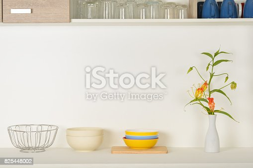 istock Flowers in the vase on the counter 825448002
