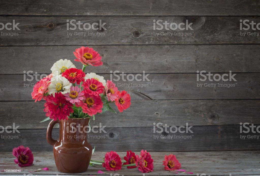 Flowers In Vase On Old Wooden Background Stock Photo More Pictures
