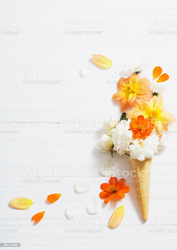 flowers in waffle cone on white wooden background royalty-free stock photo
