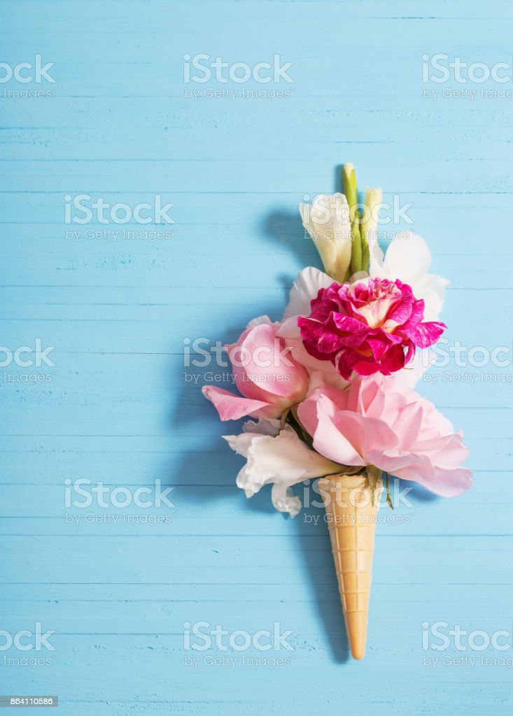 flowers in waffle cone on wooden background royalty-free stock photo