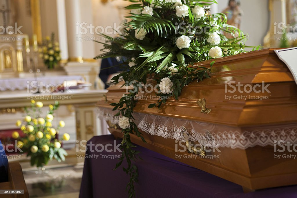 Flowers on a coffin in the church stock photo
