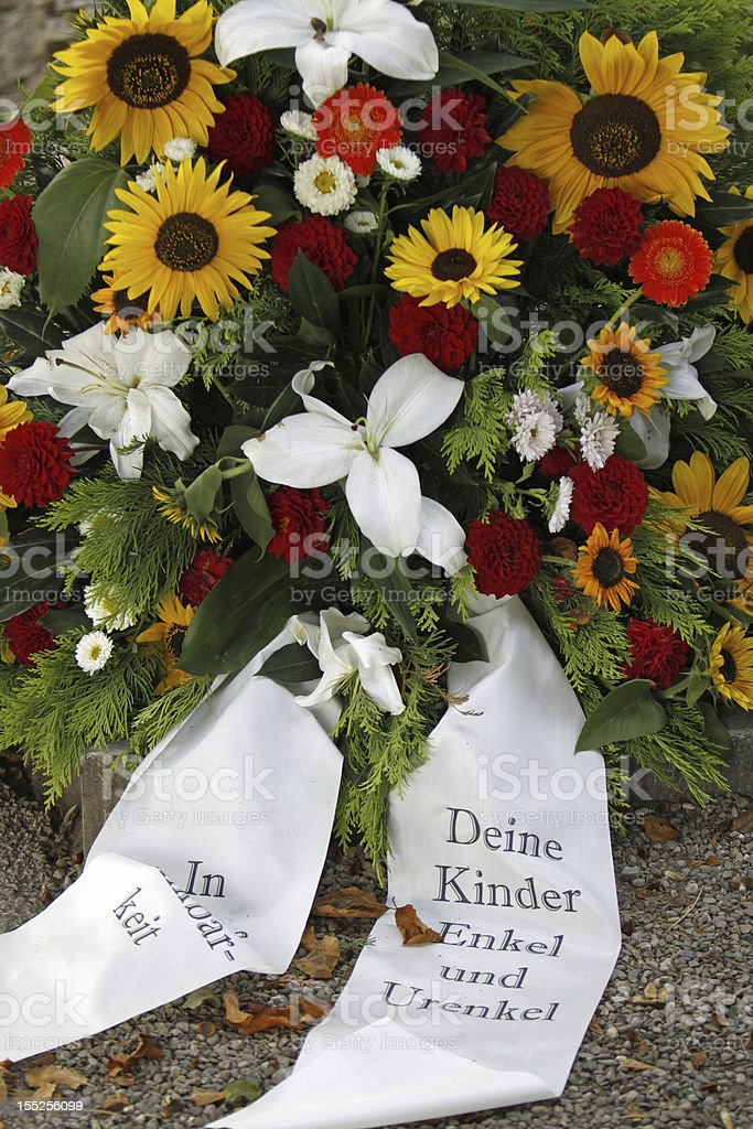 Flowers on a fresh grave stock photo