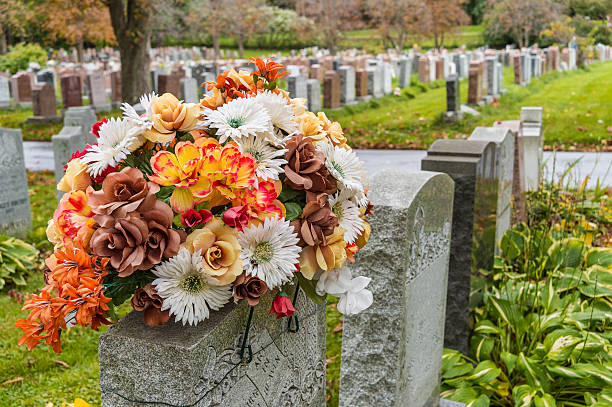 Flowers on a tombstone in a cemetary picture id513499778?b=1&k=6&m=513499778&s=612x612&w=0&h=einzjeywfgh4lcxgqlorionrjnxie3c clbto5dkdlw=