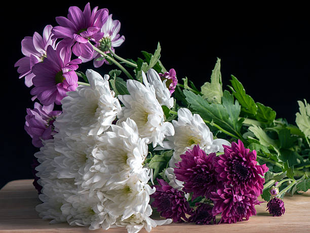 Flowers on a wooden board stock photo