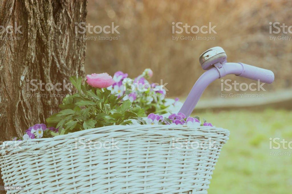 Flowers on basket ( vintage style ) stock photo