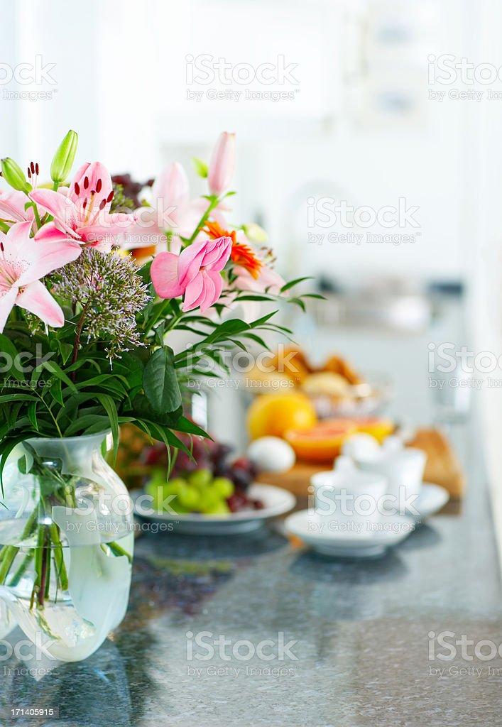Flowers on breakfast table.