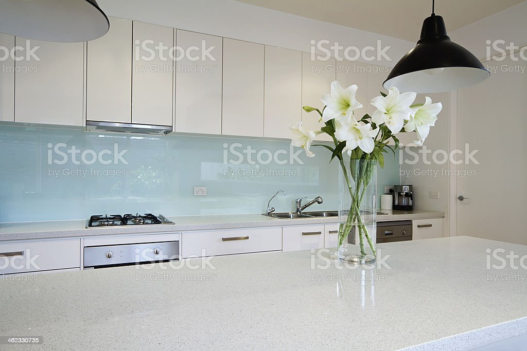 Flowers on contemporary kitchen bench stock photo