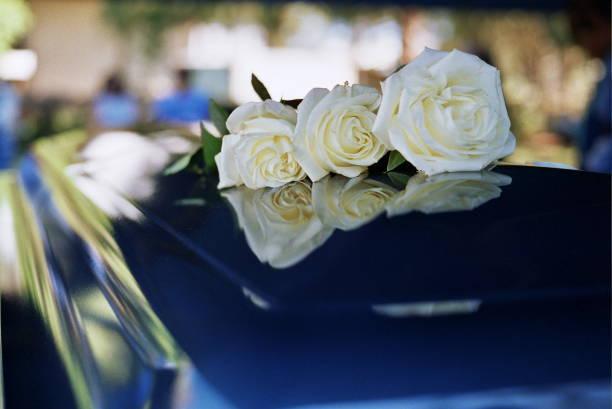 flowers on funeral coffin - funerale foto e immagini stock