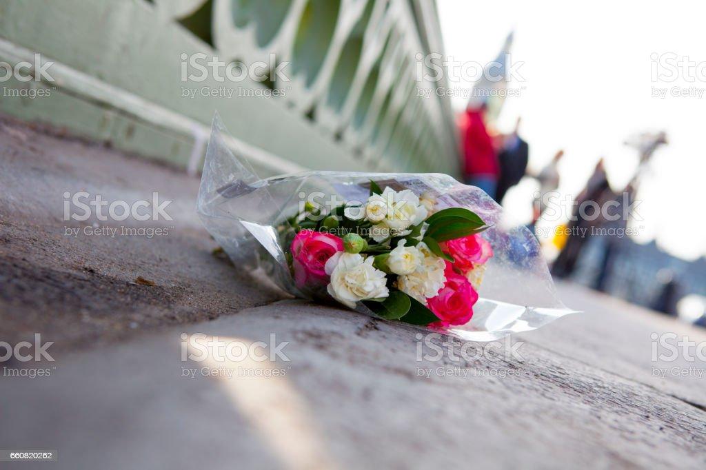 Flowers on London's Westminster bridge  - Day after terrorist attack Flowers in Westminster Bridge the day after the terrorist attack.  Bad News Stock Photo