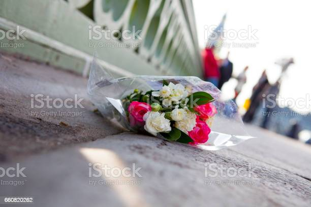 Flowers On Londons Westminster Bridge Day After Terrorist Attack Stock Photo - Download Image Now