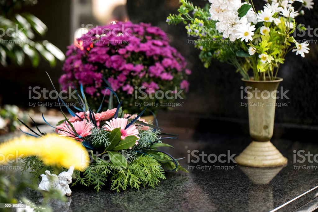 Flowers on the grave stock photo