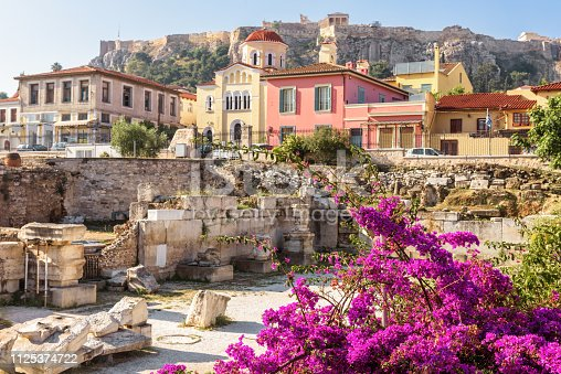 istock Flowers on the ruins of Library of Hadrian, Athens, Greece 1125374722