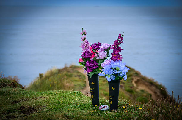 flowers on the sea shore in remembrance - zaaien stockfoto's en -beelden