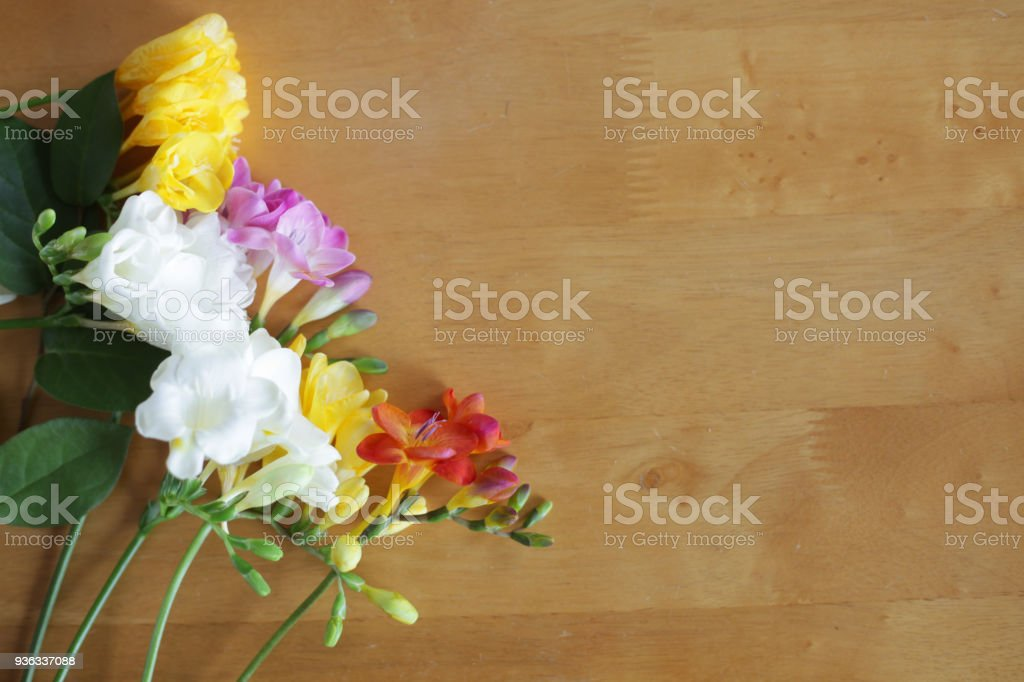 Flowers on the wooden table stock photo