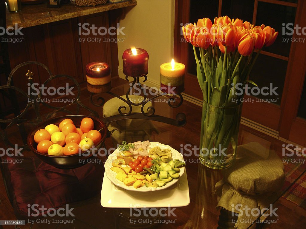 Flowers, vegetables and fruit in candlelight royalty-free stock photo