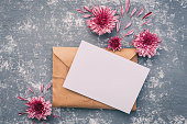 istock Flowers with blank sheet of paper ,composition flat lay. Invitation or wedding concept 654775110