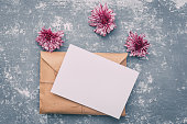 istock Flowers with blank sheet of paper ,composition flat lay. Invitation or wedding concept 654775130