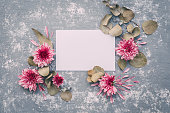 istock Flowers with blank sheet of paper ,composition flat lay. Invitation or wedding concept 654775178
