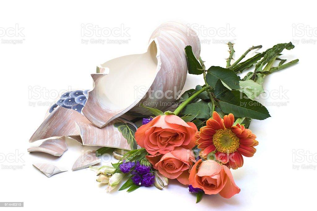 Flowers with broken vase stock photo