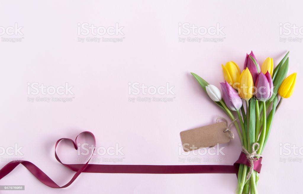Flowers with gift label stock photo