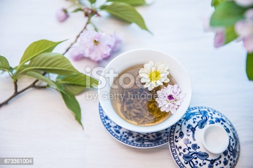 flowers with tea cup