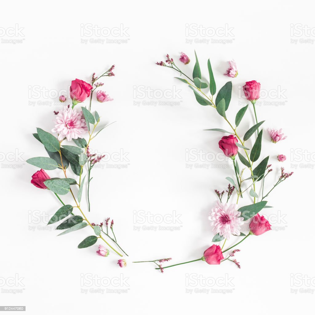 Flowers wreath on white background. Flat lay, top view stock photo