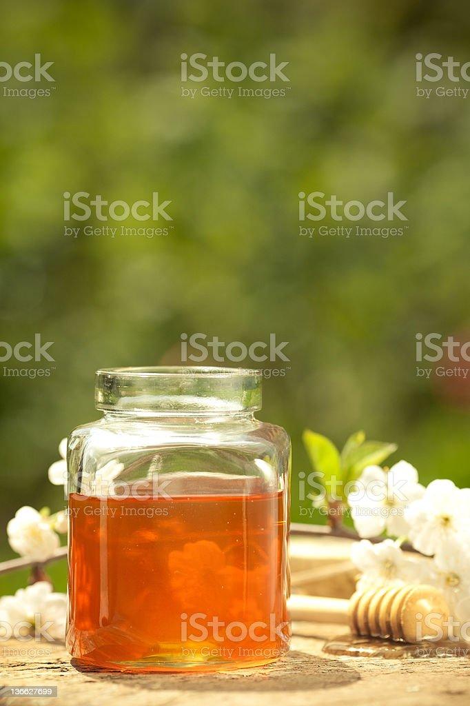 Flowery honey in glass jar royalty-free stock photo