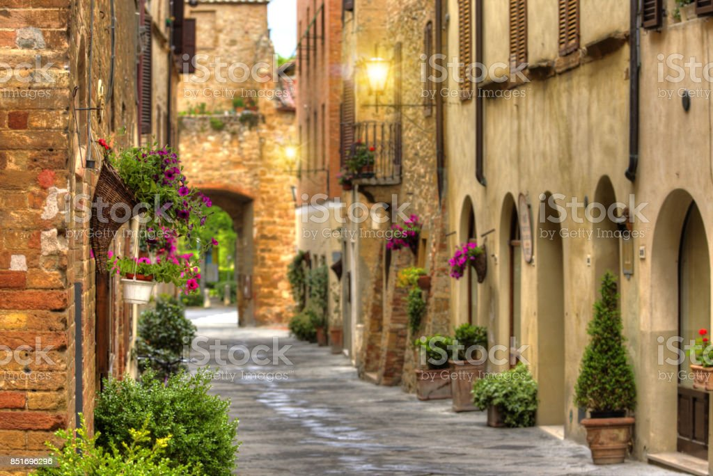 Flowery streets on a spring day in a old village Pienza stock photo