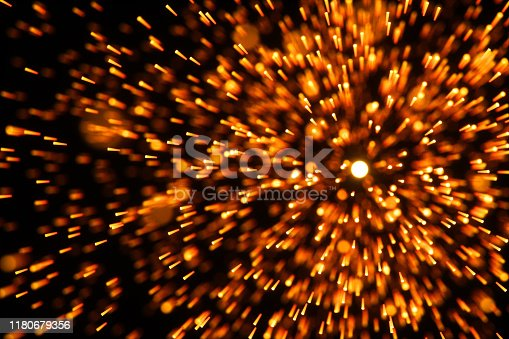 998287586 istock photo Flowing and glowing particles with dark background, 3d rendering. 1180679356