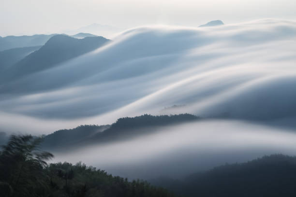 flowing clouds closeup on mountains flowing clouds closeup on mountains, spectacular clouds from waterfalls,long time exposure land feature stock pictures, royalty-free photos & images