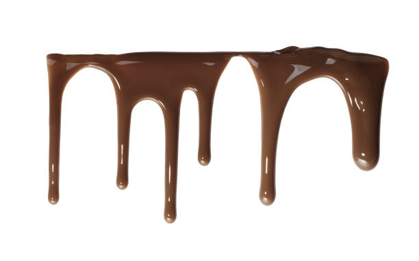Flowing down liquid chocolate stock photo