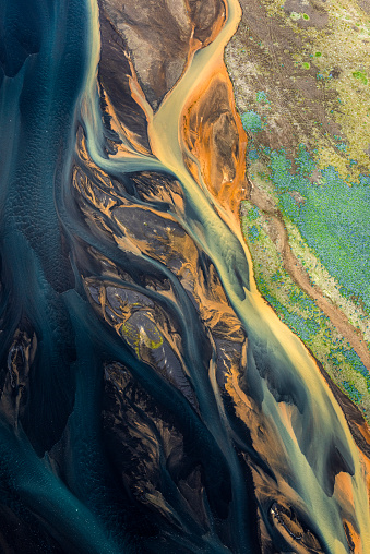 A dream-like landscape of Iceland, with flowing glacial rivers, taken from a helicopter.