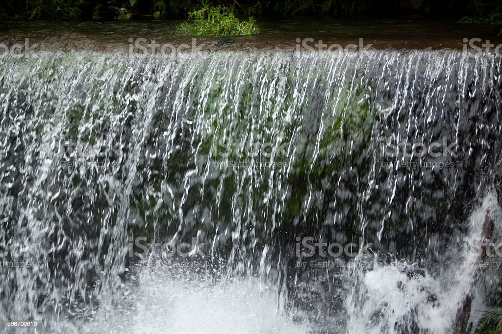 Flowing river, waterfall. stock photo