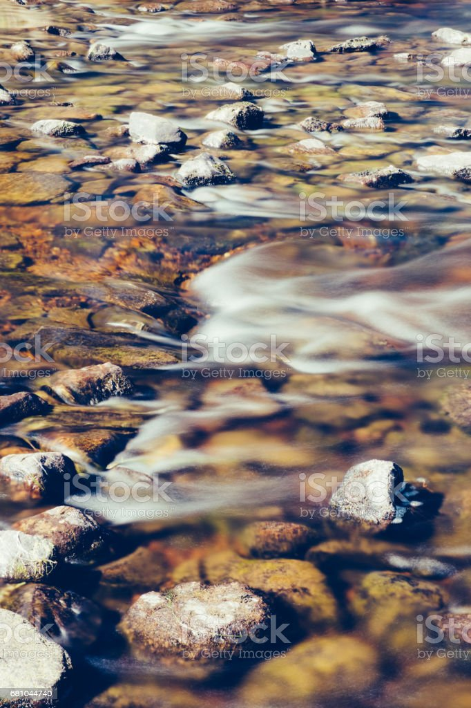 Flowing water in river, long exposure, over rocks royalty-free stock photo