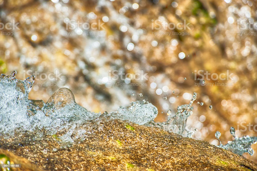 Flowing water on the rock royalty-free stock photo