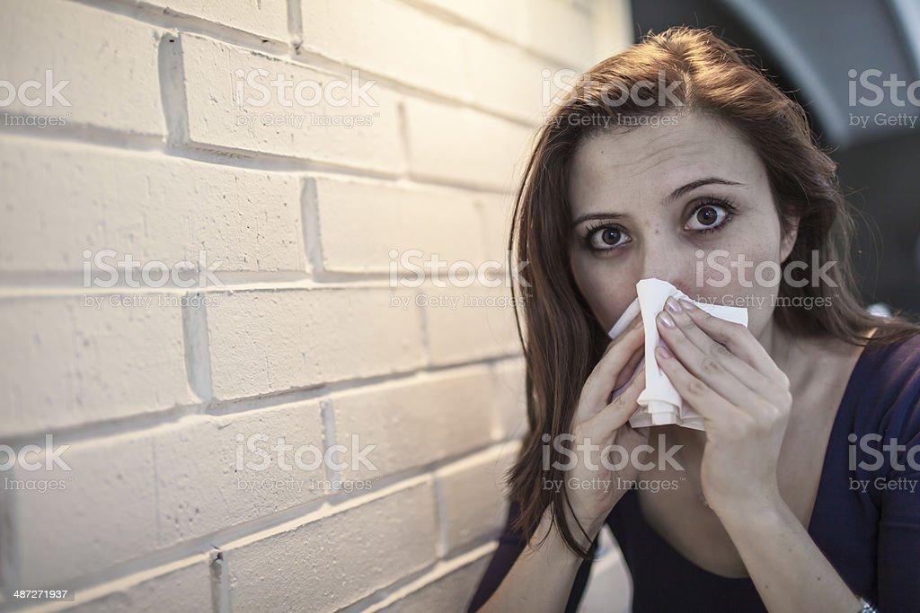 Flu allergy. Sick girl sneezing in tissue. royalty-free stock photo