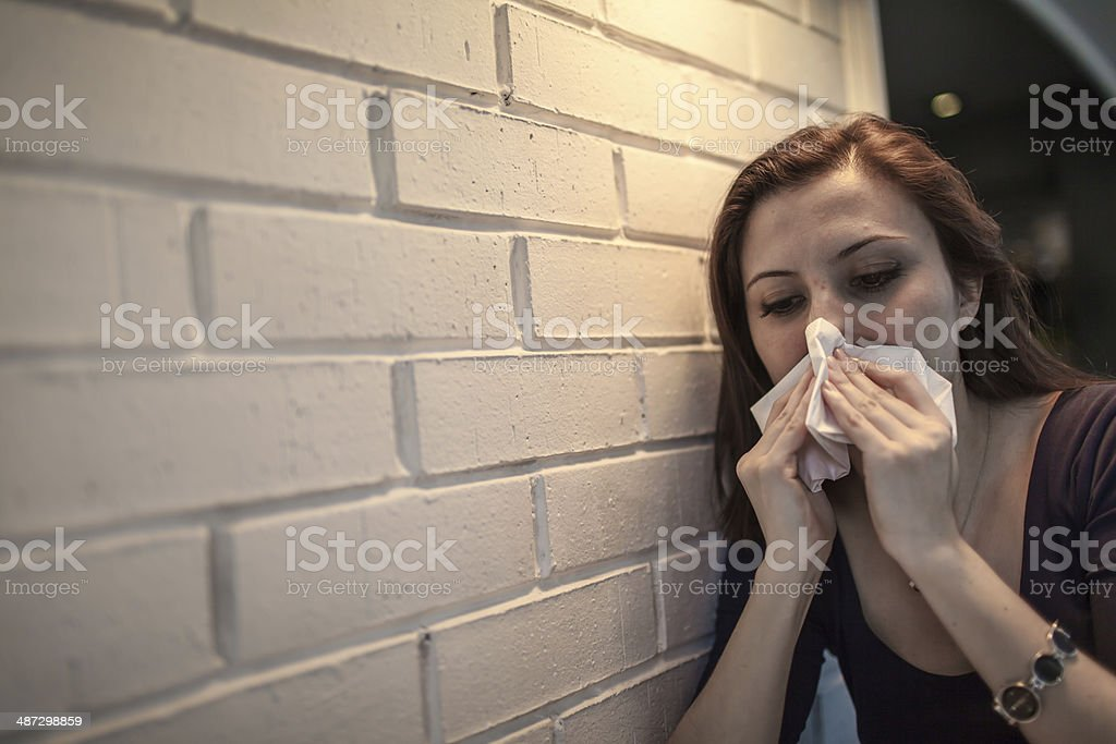 Flu allergy. Sick girl sneezing in tissue. royalty-free stock photo